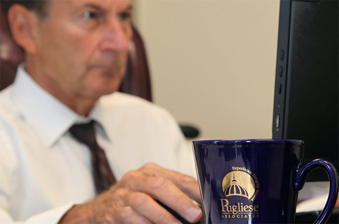 Rocco Pugliese with focus on coffee mug